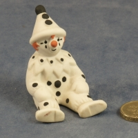 Small Clown Sitting Black Dots