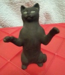 S150 - Short Haired Black Sitting Up Cat